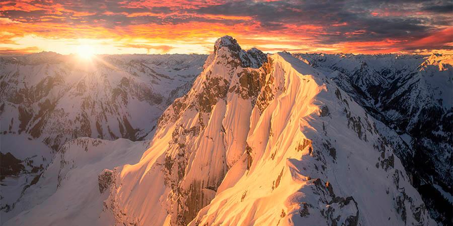 Landschaftsfotograf Jonathan Besler Winter Alpenglühen Sonnenaufgang Hinterstein