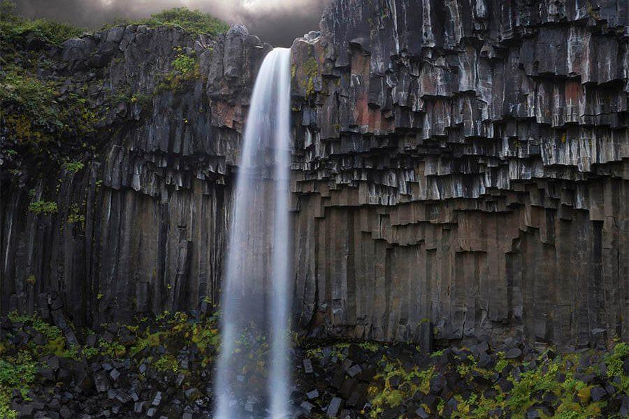 Bilder auf Leinwand Island Bilder isländisch Landschaftsbild Wasserfall Iceland Volcano Svartifoss Natur Foto Landschaft Basalt Felsen Steine